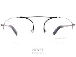 Tom Ford 5451. Lunettes optiques métal pour homme. Monture en métal gris ajourée dans le bas des verres qui sont retenus par un fil nylon.