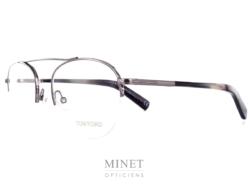 Tom Ford 5431. Lunettes optiques métal pour homme. Monture en métal gris ajourée dans le bas des verres qui sont retenus par un fil nylon.