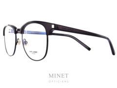 """Lunettes optique mixte Saint Laurent SL 104. Monture de forme rétro, style 50's, ayant les branches et les """"sourcils"""" en cellulo noir, tandis que le cerclage des verres et le pont sont en métal noir."""