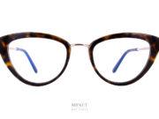 Tom Ford 5580. Lunettes optiques pour dames. Ce sont des montures combinées métal et acétate de cellulose. De forme très papillonnantes, elles nous rappellent les formes des lunettes américaine des 50's, 60's.